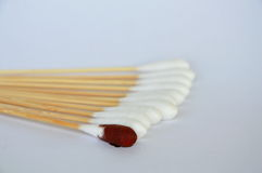 Cotton bud with iodine solution on white background. Cotton bud with iodine solution on the white background royalty free stock photos