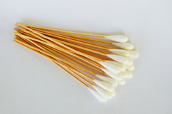 Cotton bud with long wooden stick on white background Stock Photos