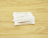 Cotton bud on wooden table Royalty Free Stock Photography