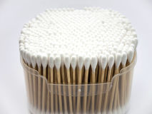 Cotton buds in box on white background. Stock Photos