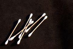 Cotton buds on black royalty free stock photo