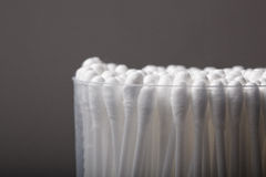 Cotton buds with plastic packing on a dark background Stock Images
