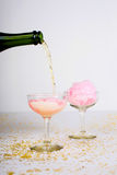 Cotton Candy Champagne Cocktail. Pouring a cotton candy champagne cocktail for Valentine`s Day royalty free stock photography