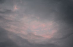 Cotton Candy Clouds. Dusk arrives with shades of pink to highlight the evening sky Royalty Free Stock Photo