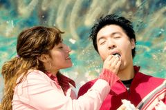 Cotton candy date. Young couple enjoying a date while the girl feeds the guy Cotton Candy Stock Photos