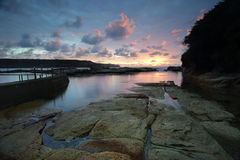 Cotton Candy Sunrise at Malabar, Sydney Australia. Sunrise over beautiful Malabar, just 12km from Sydney CBD.  This natural rock pool lies beside the man made Stock Image
