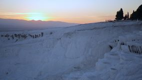 Cotton Castle in Pamukkale Turkey during sunset. Beautiful sunset in Cotton Castle in Pamukkale Turkey, fastly moving people on the background stock video