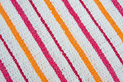 Cotton cleaning cloth. Possible background. A close up image of a patterned cleaning cloth with colored stripes Stock Images