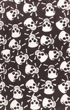 Cotton cloth with a pattern of skulls and bones. Color print on cotton fabric. White skulls and bones on a black background Royalty Free Stock Photography