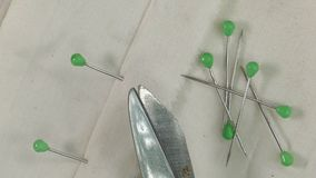Cotton cloth, scissors and needle on a turntable. Needles with heads are used to appoint the tissues stock video