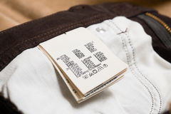 Cotton clothing label or tag Stock Photos