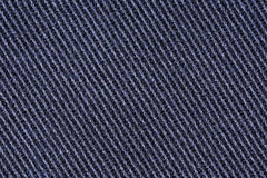 Cotton denim jeans fabric texture background, close up Royalty Free Stock Photography
