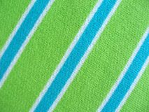 Cotton fabric with blue green and white stripes stock image