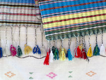 Cotton fabric with  fringes. Part of colourful traditional  handmade craft - cotton fabric with  fringes -Close up Stock Image