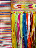 Cotton fabric with  fringes. Part of colourful traditional  handmade craft - cotton fabric with  fringes -Close up Royalty Free Stock Photography