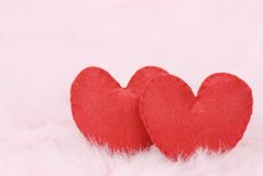 Cotton fabric hearts on feather Royalty Free Stock Photo