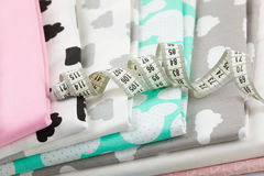 Cotton fabric material and tailor measurement tape Royalty Free Stock Photography