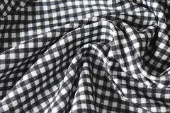 Cotton fabric natural and has a soft ripple. Grid pattern black and white and rough surface background. Cotton fabric natural and has a soft ripple. Grid stock photography