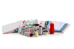 Cotton fabric, tailor measurement tape and spools of cotton thre Royalty Free Stock Photography