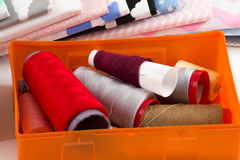 Cotton fabric, tailor measurement tape and spools of cotton thre Royalty Free Stock Photo