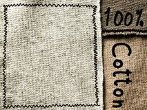 Cotton fabric textile with text, background texture Royalty Free Stock Photo