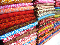 Cotton Fabrics. Stacks of designer colorful cotton fabrics royalty free stock photo