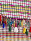 Cotton fabrics with  fringes. Part of colourful traditional  handmade craft - cotton fabric with  fringes -Close up Stock Image