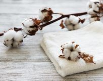Cotton flower and towel. On a old wooden table stock photography