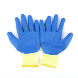 Cotton gloves with blue rubber on surface Royalty Free Stock Image