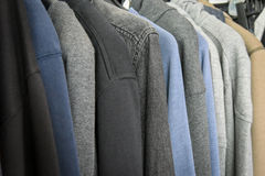 Cotton jackets on the rack. Close up of cotton jackets on the rack Royalty Free Stock Photo