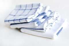 Cotton kitchen napkins on the white concrete table.Scandynavian. Some white cotton napkins on the kitchen table. Ecofriendly fabric and lifestyle stock photo