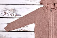 Cotton knitted pullover. Brown hooded knitted cardigan for children on sale. High quality winter knit outfit Stock Images