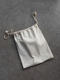Cotton laundry bag. On cement floor background stock images