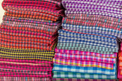 Cotton material in piles, shop, cambodia Stock Image