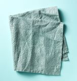 Cotton napkin on blue, from above Stock Images
