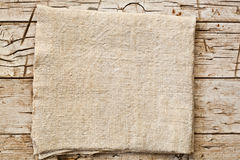 Cotton napkin on old wooden table Royalty Free Stock Photography