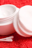 Cotton pads and facial creme Royalty Free Stock Photo