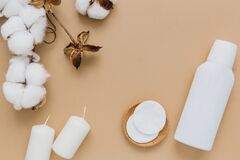 Free Cotton Pads For Removing Makeup, Cosmetic Product, Candles And Branch Of Cotton Plant On Beige Background, Flat Lay. Spa Concept Stock Photography - 207466942