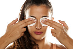Cotton pads on her eyes Stock Image