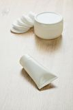 Cotton pads tube and jar Stock Photos