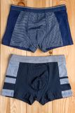 Cotton panties for boy clothes on wooden boards. Top view stock image