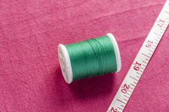 Cotton reel and meter tape Royalty Free Stock Photos