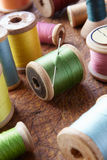 Cotton reels on table top. Close up shot of multi colored cotton reels on table top stock photography