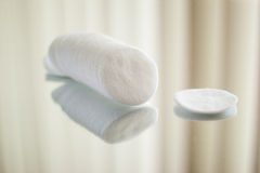 Cotton round cosmetic pads. On reflective surface Stock Photo