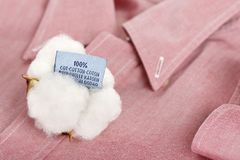 Cotton shirt. Cotton ball with label on red shirt Stock Photo