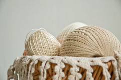 Cotton skeins in a basket Stock Images