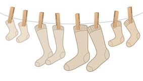 Cotton Socks On Clothesline Family Pack. Cotton socks - brown, woolen family pack on clothesline - for mum, dad, kid and baby. Isolated vector comic illustration Stock Photography