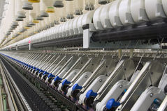 Cotton Spinning Machine_5. Deep perspective of textile spinning machine in factory Stock Photography