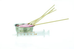 Cotton stick with chlorhexidine for cleaning and syringe Stock Photo