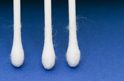 Cotton sticks. Cotton fiocs on blue background Stock Photos
